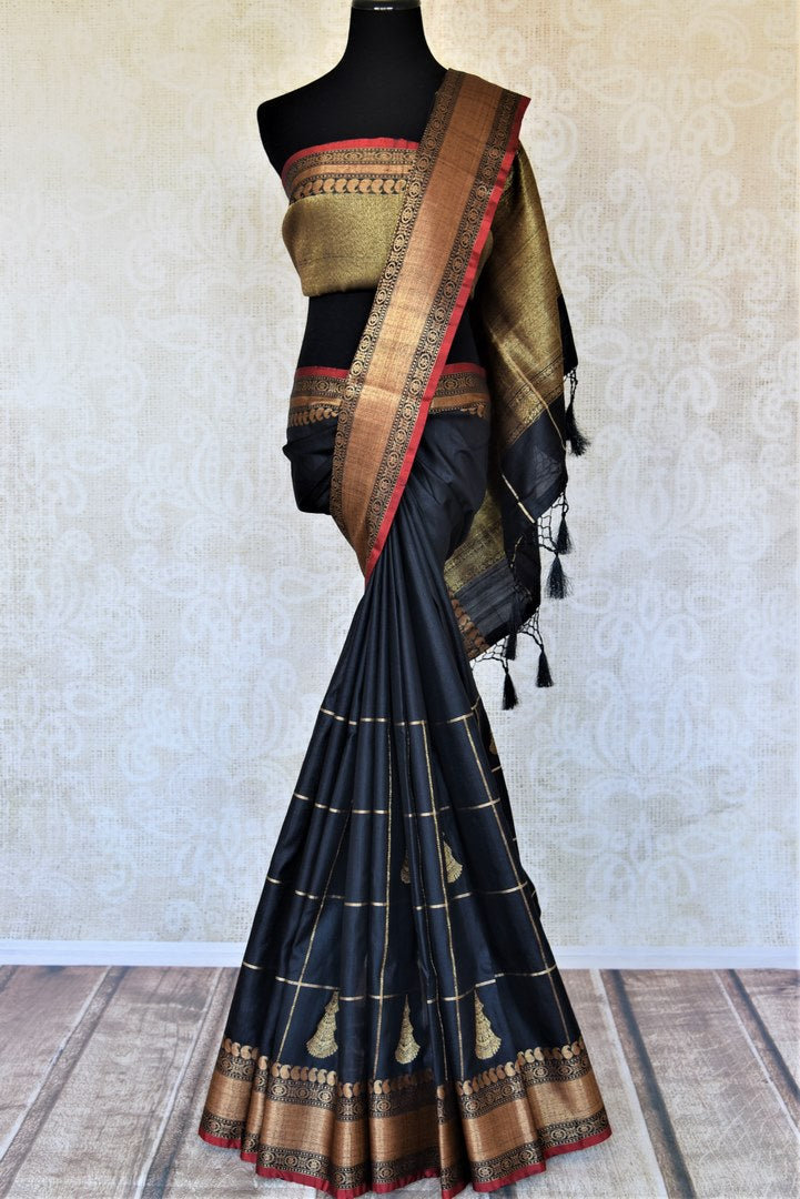 Shop stunning black tassar Banarasi saree online in USA with zari checks and antique zari border. For Indian women in USA, Pure Elegance Indian fashion store brings an exquisite collection Banarasi sarees, Banarasi silk saris, tussar sarees,  work sarees, pure silk sarees all under one roof. Shop online now.-full view