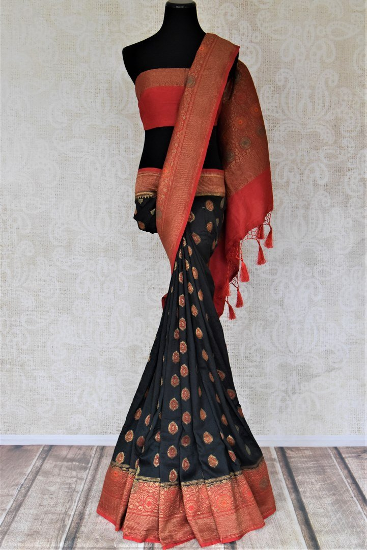 Buy ravishing black muga Banarasi saree online in USA with red antique zari floral border. Keep your ethnic style updated with latest designer sarees, handloom sarees, pure silk sarees from Pure Elegance Indian fashion store in USA.-full view