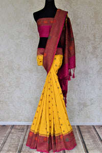 Buy yellow muga Benarasi saree online in USA with pink antique zari floral border. Keep your ethnic style updated with latest designer sarees, handloom sarees, muga silk sarees from Pure Elegance Indian fashion store in USA.-full view