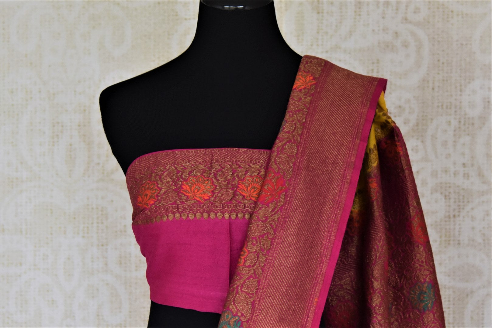 Buy yellow muga Benarasi saree online in USA with pink antique zari floral border. Keep your ethnic style updated with latest designer sarees, handloom sarees, muga silk sarees from Pure Elegance Indian fashion store in USA.-blouse pallu