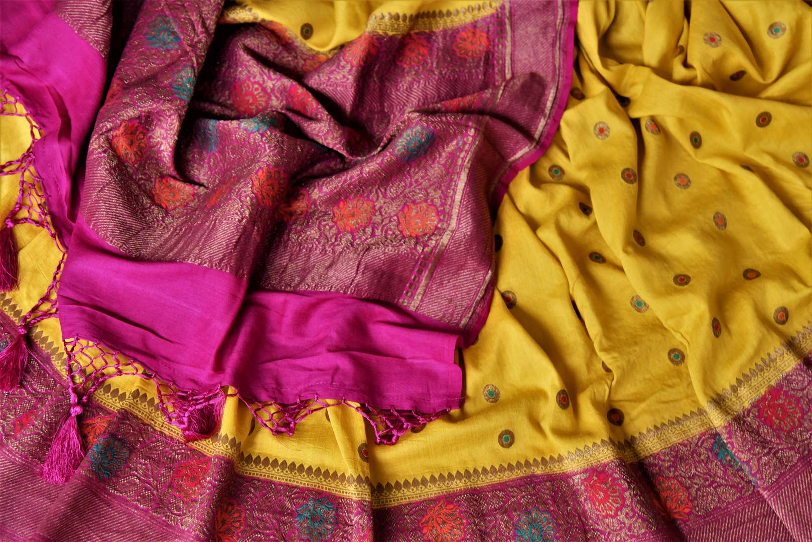 Buy yellow muga Benarasi saree online in USA with pink antique zari floral border. Keep your ethnic style updated with latest designer sarees, handloom sarees, muga silk sarees from Pure Elegance Indian fashion store in USA.-details