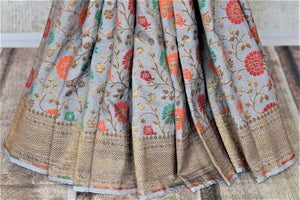 Shop gorgeous light grey minakari weave Banarasi saree online in USA. Keep it light yet festive on special occasions with beautiful handwoven saris, Banarasi sarees from Pure Elegance Indian fashion store in USA.-pleats