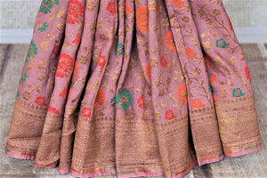 Shop beautiful blush pink minakari weave Banarasi saree online in USA with zari work. Keep it light yet festive on special occasions with beautiful handwoven saris, Banarasi sarees from Pure Elegance Indian fashion store in USA.-pleats