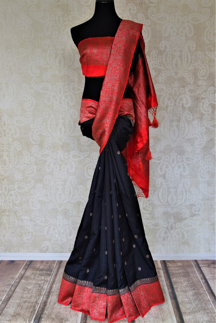 Buy black tussar Banarasi sari online in USA with zari buta and red zari border. Choose tasteful handloom saris for special occasions from Pure Elegance. Our exclusive Indian fashion store has a myriad of exquisite pure silk saris, tussar sarees, Banarasi sarees for Indian women in USA.-full view