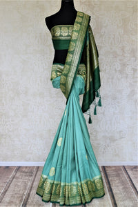 Buy beautiful sea green tussar Banarsi saree online in USA with floral zari buta border. Be the center of attraction at parties and weddings with beautiful Kanchipuram silk sarees, pure silk sarees, handwoven sarees, Banarasi sarees from Pure Elegance Indian fashion store in USA.-full view