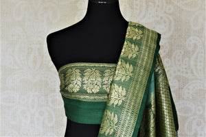 Buy beautiful sea green tussar Banarsi saree online in USA with floral zari buta border. Be the center of attraction at parties and weddings with beautiful Kanchipuram silk sarees, pure silk sarees, handwoven sarees, Banarasi sarees from Pure Elegance Indian fashion store in USA.-blouse pallu
