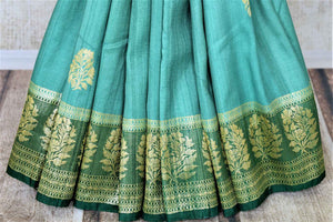 Buy beautiful sea green tussar Banarsi saree online in USA with floral zari buta border. Be the center of attraction at parties and weddings with beautiful Kanchipuram silk sarees, pure silk sarees, handwoven sarees, Banarasi sarees from Pure Elegance Indian fashion store in USA.-pleats