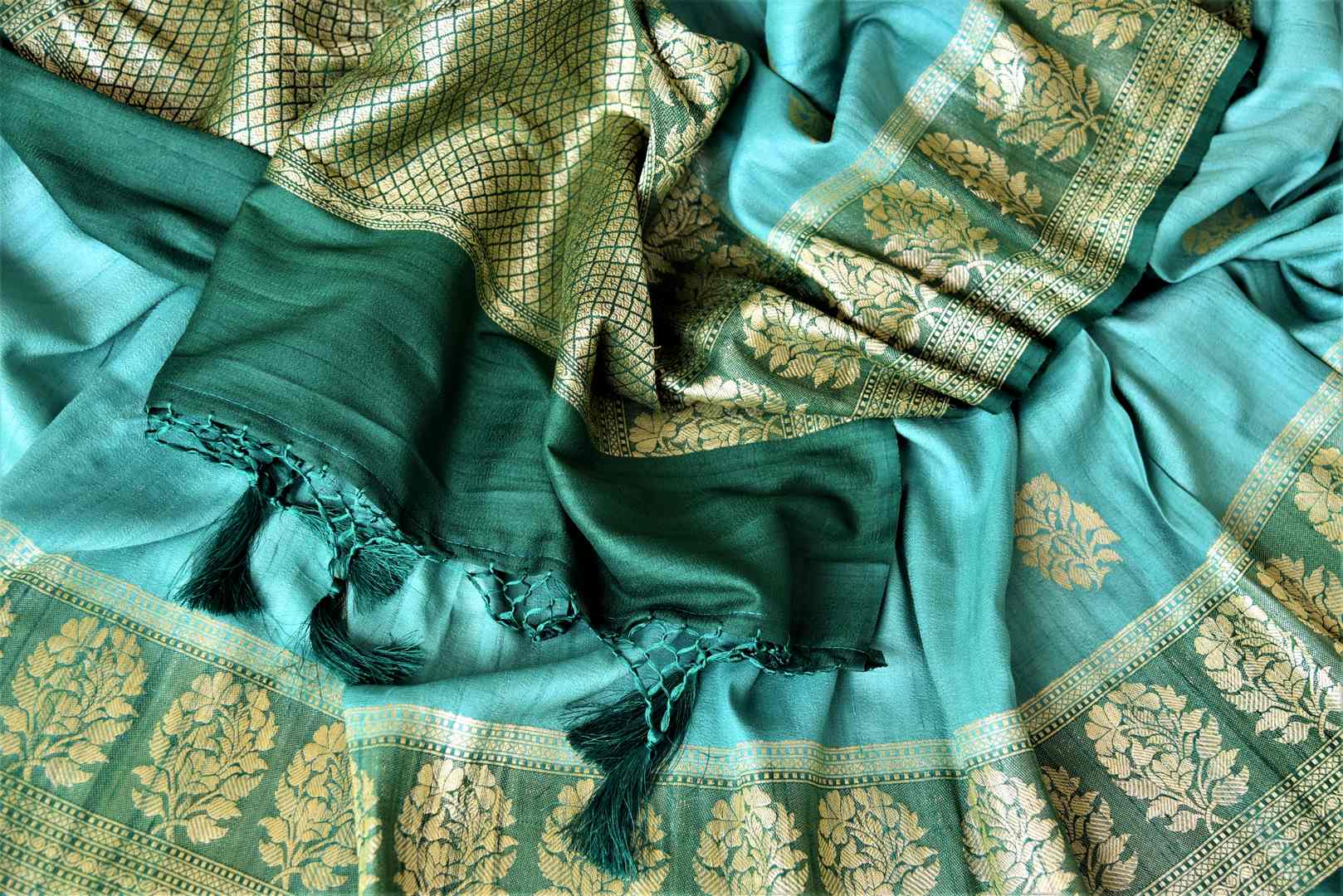 Buy beautiful sea green tussar Banarsi saree online in USA with floral zari buta border. Be the center of attraction at parties and weddings with beautiful Kanchipuram silk sarees, pure silk sarees, handwoven sarees, Banarasi sarees from Pure Elegance Indian fashion store in USA.-details