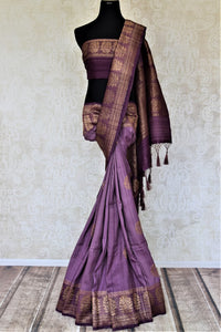 Shop beautiful purple tussar Benarasi saree online in USA with floral zari buta border. Be the center of attraction at parties and weddings with beautiful Banarasi silk sarees, pure silk sarees, handwoven sarees, Banarasi saris from Pure Elegance Indian fashion store in USA.-full view