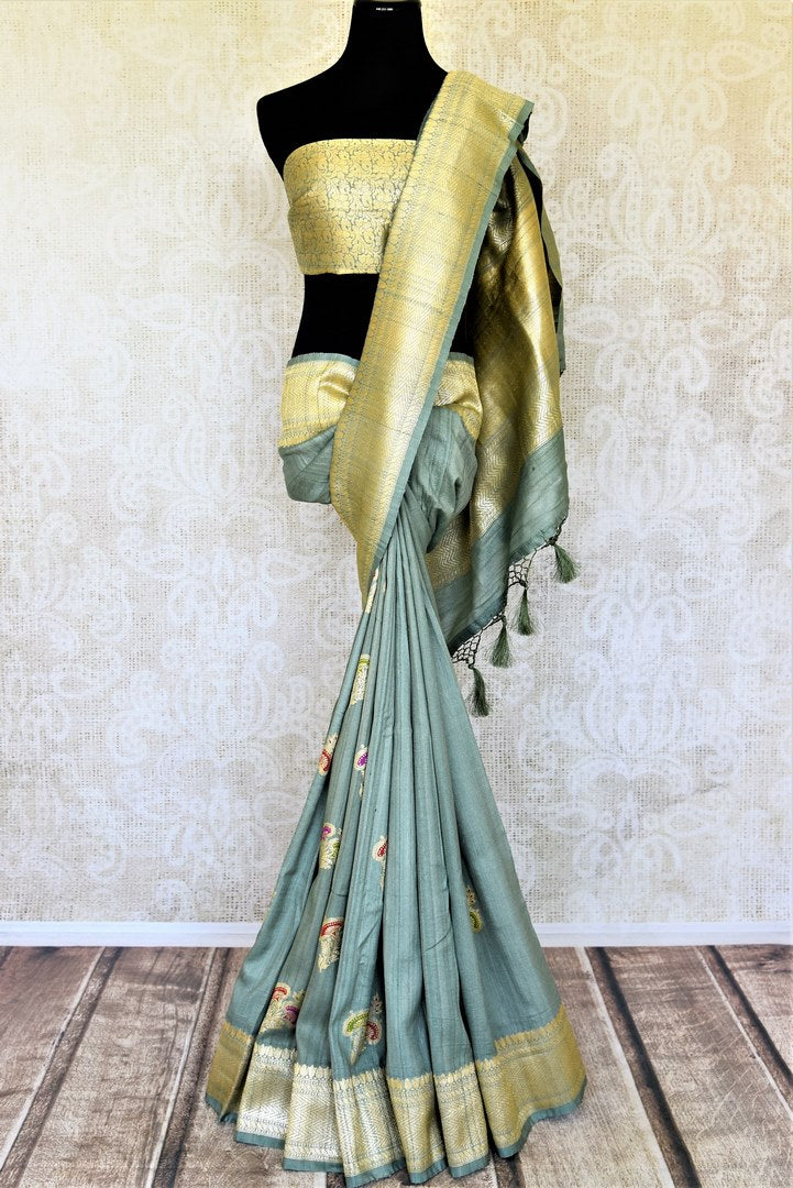 Shop gorgeous tea green tussar Banarasi saree online in USA with zari minakari floral buta. Be the center of attraction at weddings and parties with beautiful silk sarees, tussar sarees, embroidered sarees, partywear sarees, fancy sarees from Pure Elegance Indian fashion store in USA. -full view