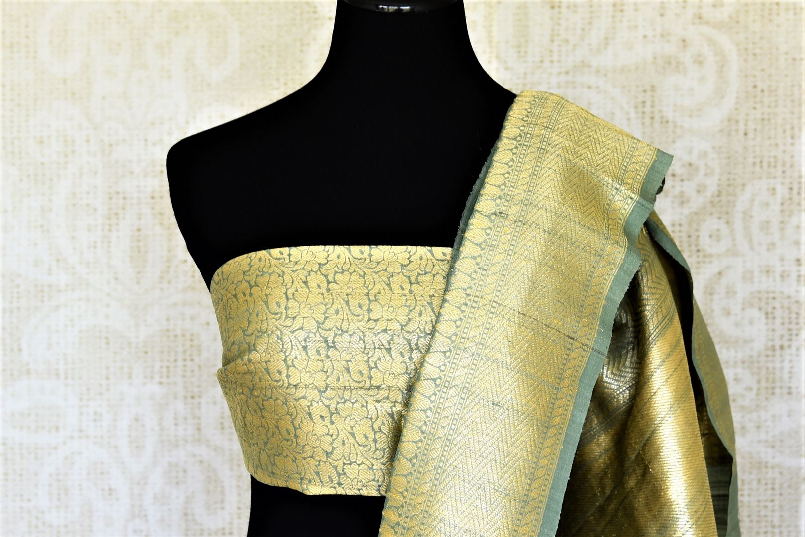 Shop gorgeous tea green tussar Banarasi saree online in USA with zari minakari floral buta. Be the center of attraction at weddings and parties with beautiful silk sarees, tussar sarees, embroidered sarees, partywear sarees, fancy sarees from Pure Elegance Indian fashion store in USA. -blouse pallu