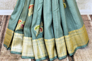 Shop gorgeous tea green tussar Banarasi saree online in USA with zari minakari floral buta. Be the center of attraction at weddings and parties with beautiful silk sarees, tussar sarees, embroidered sarees, partywear sarees, fancy sarees from Pure Elegance Indian fashion store in USA. -pleats