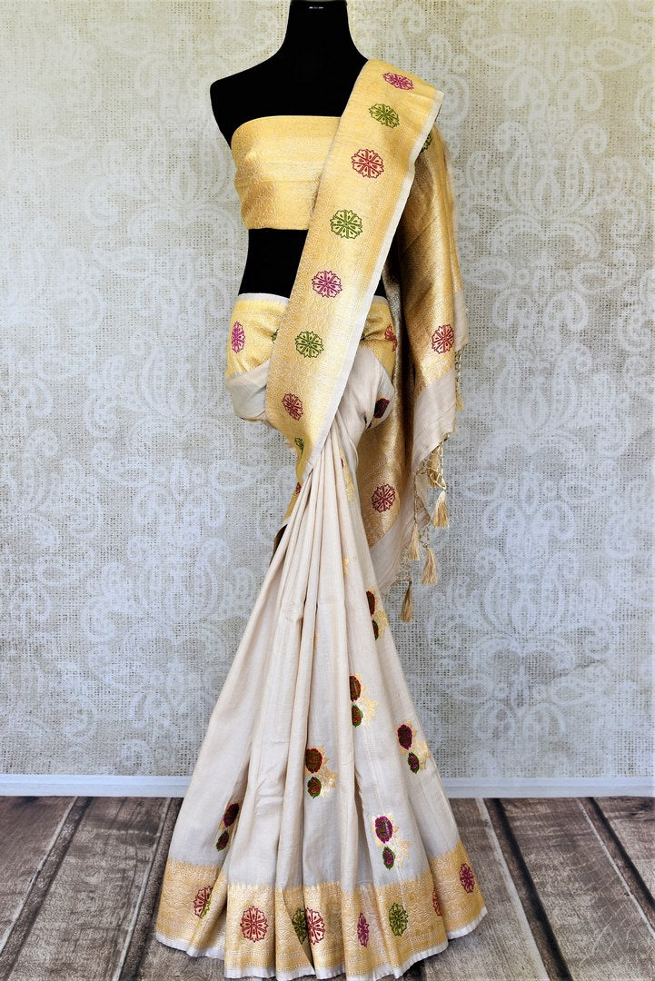 Buy beautiul cream tussar Banarsi saree online in USA with rose minakari zari buta. Be the center of attraction at weddings and parties with beautiful silk sarees, tussar sarees, embroidered sarees, partywear sarees, fancy sarees from Pure Elegance Indian fashion store in USA. -full view
