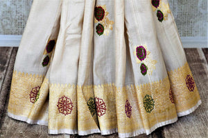 Buy beautiul cream tussar Banarsi saree online in USA with rose minakari zari buta. Be the center of attraction at weddings and parties with beautiful silk sarees, tussar sarees, embroidered sarees, partywear sarees, fancy sarees from Pure Elegance Indian fashion store in USA. -pleats