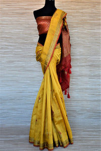 Shop beautiful yellow tassar Benarasi saree online in USA with antique zari floral border. Wear designer sarees, Banarasi sarees, handwoven tussar sarees on special occasions from Pure Elegance Indian clothing store in USA. -full view