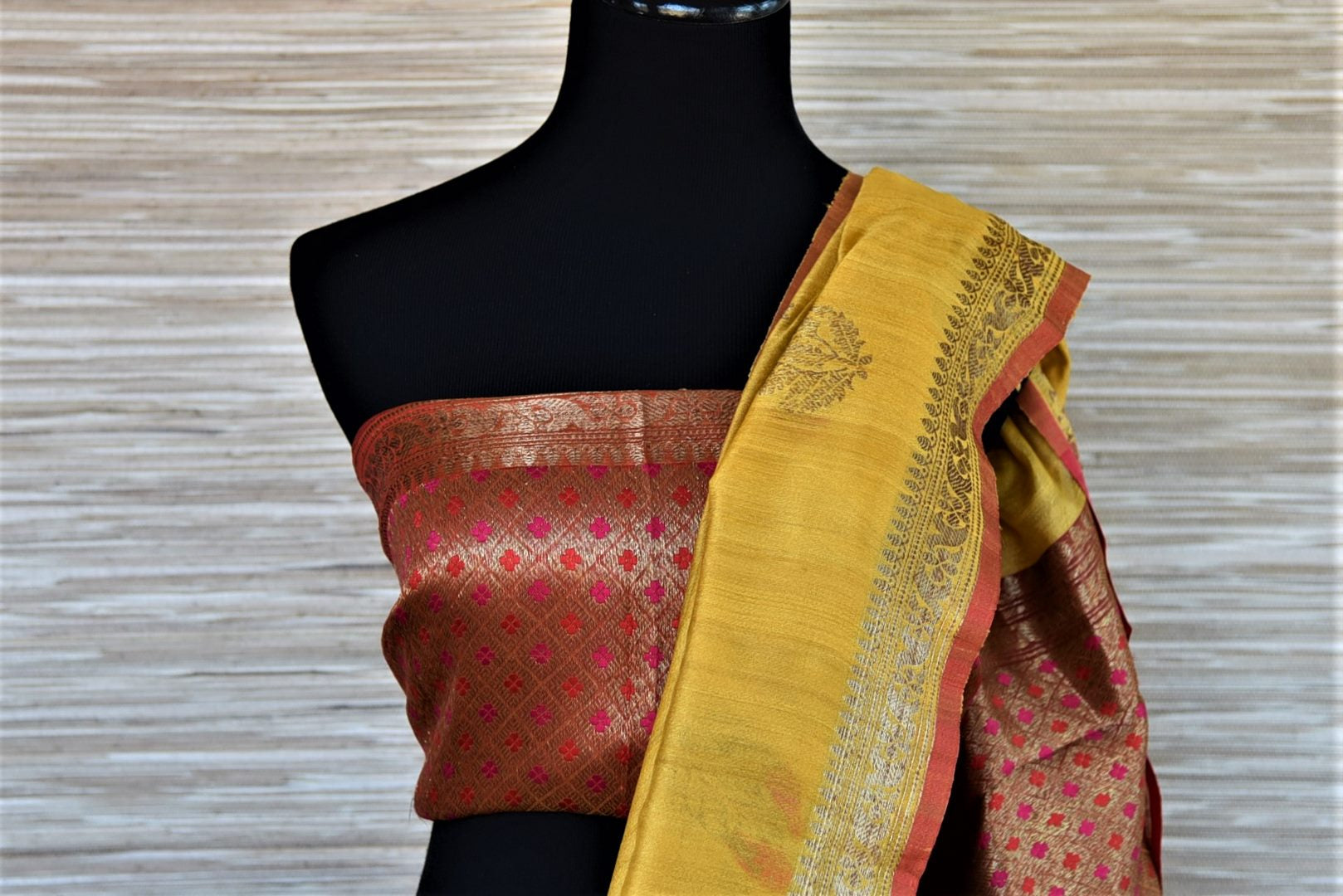 Shop beautiful yellow tassar Benarasi saree online in USA with antique zari floral border. Wear designer sarees, Banarasi sarees, handwoven tussar sarees on special occasions from Pure Elegance Indian clothing store in USA. -blouse pallu