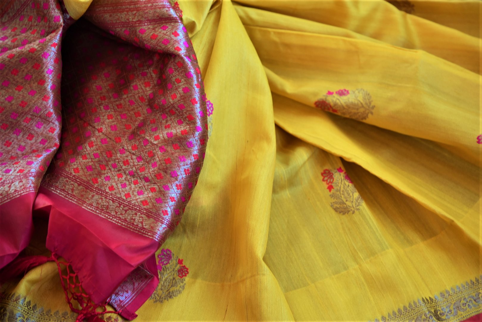 Shop beautiful yellow tassar Benarasi saree online in USA with antique zari floral border. Wear designer sarees, Banarasi sarees, handwoven tussar sarees on special occasions from Pure Elegance Indian clothing store in USA. -details