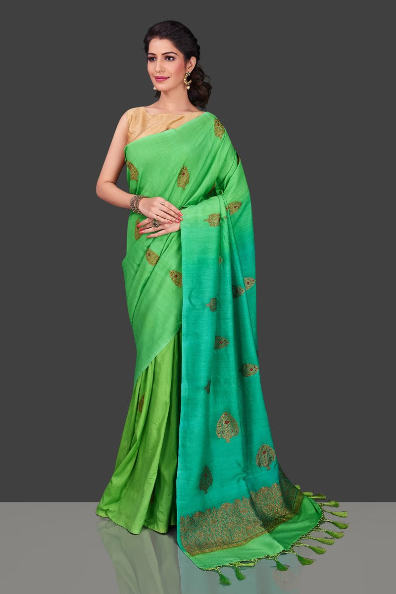 Shop alluring ombre green borderless muga Banarasi saree online in USA with antique zari buta. Shop beautiful Banarasi sarees, pure muga silk sarees in USA from Pure Elegance Indian fashion boutique in USA. Get spoiled for choices with a splendid variety of Indian saris to choose from! Shop now.-full view
