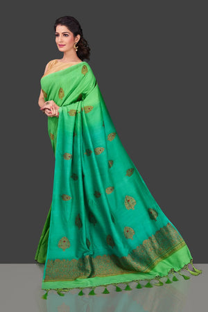 Shop alluring ombre green borderless muga Banarasi saree online in USA with antique zari buta. Shop beautiful Banarasi sarees, pure muga silk sarees in USA from Pure Elegance Indian fashion boutique in USA. Get spoiled for choices with a splendid variety of Indian saris to choose from! Shop now.-side