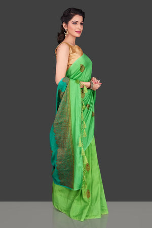 Shop alluring ombre green borderless muga Banarasi saree online in USA with antique zari buta. Shop beautiful Banarasi sarees, pure muga silk sarees in USA from Pure Elegance Indian fashion boutique in USA. Get spoiled for choices with a splendid variety of Indian saris to choose from! Shop now.-left