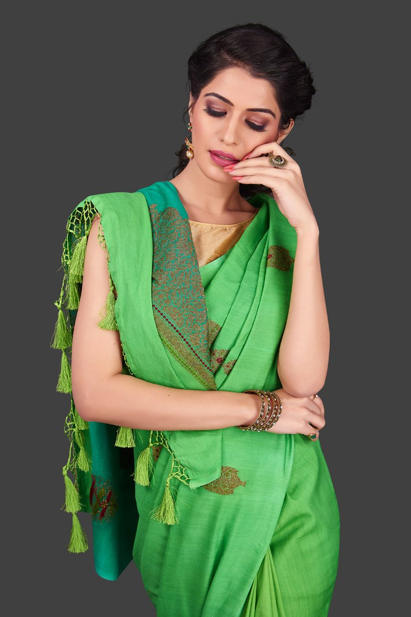 Shop alluring ombre green borderless muga Banarasi saree online in USA with antique zari buta. Shop beautiful Banarasi sarees, pure muga silk sarees in USA from Pure Elegance Indian fashion boutique in USA. Get spoiled for choices with a splendid variety of Indian saris to choose from! Shop now.-closeup