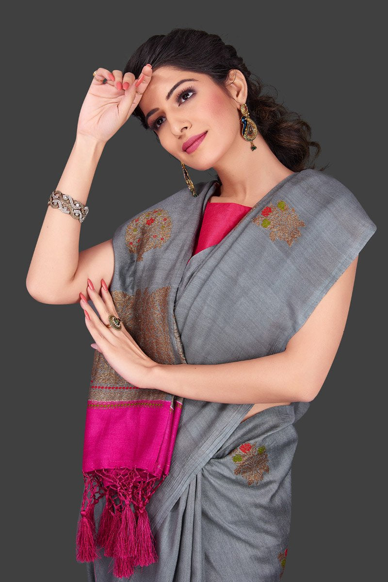 Shop lovely grey borderless muga Banarasi sari online in USA with antique zari buta. Shop beautiful Banarasi sarees, georgette sarees, pure muga silk sarees in USA from Pure Elegance Indian fashion boutique in USA. Get spoiled for choices with a splendid variety of Indian saris to choose from! Shop now.-closeup