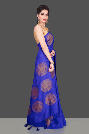 Shop attractive indigo blue borderless muga Banarasi saree online in USA with big zari buta. Shop beautiful Banarasi sarees, georgette sarees, pure muga silk sarees in USA from Pure Elegance Indian fashion boutique in USA. Get spoiled for choices with a splendid variety of Indian saris to choose from! Shop now.-side