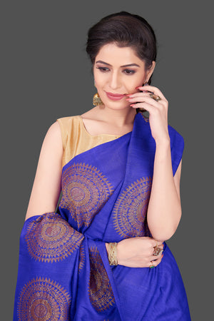 Shop attractive indigo blue borderless muga Banarasi saree online in USA with big zari buta. Shop beautiful Banarasi sarees, georgette sarees, pure muga silk sarees in USA from Pure Elegance Indian fashion boutique in USA. Get spoiled for choices with a splendid variety of Indian saris to choose from! Shop now.-closeup