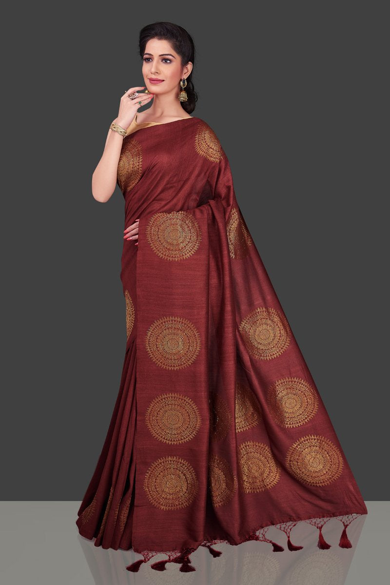 Buy elegant maroon borderless muga Benarasi saree online in USA with big antique zari buta. Shop beautiful Banarasi sarees, georgette sarees, pure muga silk sarees in USA from Pure Elegance Indian fashion boutique in USA. Get spoiled for choices with a splendid variety of Indian saris to choose from! Shop now.-front