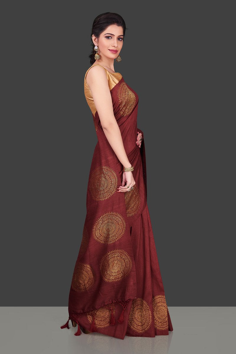 Buy elegant maroon borderless muga Benarasi saree online in USA with big antique zari buta. Shop beautiful Banarasi sarees, georgette sarees, pure muga silk sarees in USA from Pure Elegance Indian fashion boutique in USA. Get spoiled for choices with a splendid variety of Indian saris to choose from! Shop now.-side