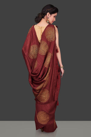 Buy elegant maroon borderless muga Benarasi saree online in USA with big antique zari buta. Shop beautiful Banarasi sarees, georgette sarees, pure muga silk sarees in USA from Pure Elegance Indian fashion boutique in USA. Get spoiled for choices with a splendid variety of Indian saris to choose from! Shop now.-back