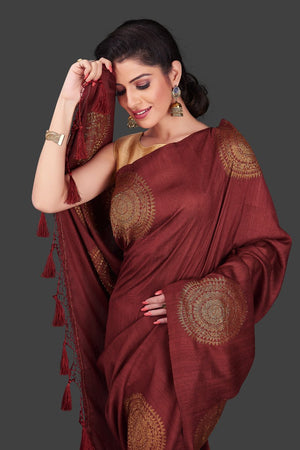 Buy elegant maroon borderless muga Benarasi saree online in USA with big antique zari buta. Shop beautiful Banarasi sarees, georgette sarees, pure muga silk sarees in USA from Pure Elegance Indian fashion boutique in USA. Get spoiled for choices with a splendid variety of Indian saris to choose from! Shop now.-closeup