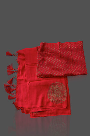 Shop stunning red borderless muga Banarasi sari online in USA with big antique zari buta. Shop beautiful Banarasi sarees, georgette sarees, pure muga silk sarees in USA from Pure Elegance Indian fashion boutique in USA. Get spoiled for choices with a splendid variety of Indian saris to choose from! Shop now.-details