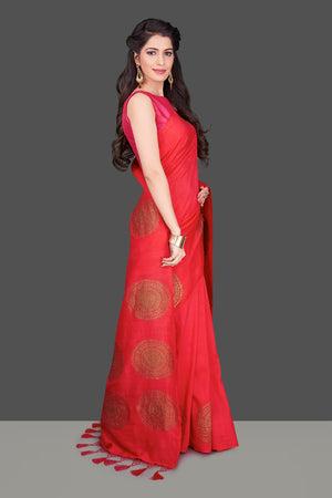 Shop stunning red borderless muga Banarasi sari online in USA with big antique zari buta. Shop beautiful Banarasi sarees, georgette sarees, pure muga silk sarees in USA from Pure Elegance Indian fashion boutique in USA. Get spoiled for choices with a splendid variety of Indian saris to choose from! Shop now.-side
