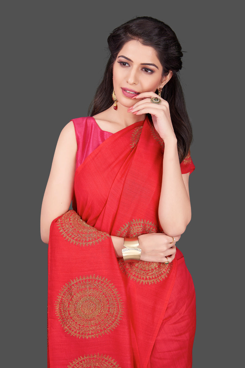 Shop stunning red borderless muga Banarasi sari online in USA with big antique zari buta. Shop beautiful Banarasi sarees, georgette sarees, pure muga silk sarees in USA from Pure Elegance Indian fashion boutique in USA. Get spoiled for choices with a splendid variety of Indian saris to choose from! Shop now.-closeup