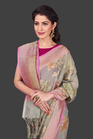 Shop gorgeous light grey georgette Banarasi saree online in USA with floral zari jaal. Shop beautiful Banarasi sarees, georgette sarees, pure muga silk sarees in USA from Pure Elegance Indian fashion boutique in USA. Get spoiled for choices with a splendid variety of Indian saris to choose from! Shop now.-closeup
