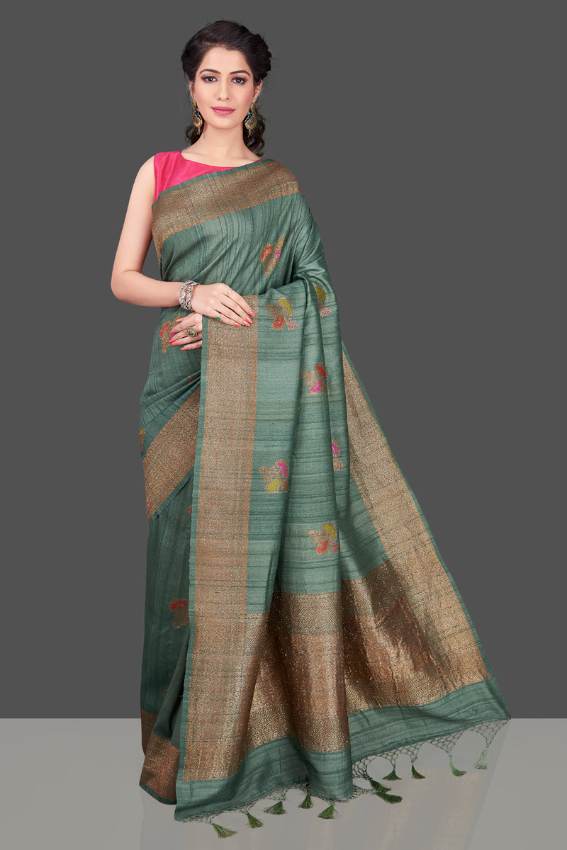Shop elegant green tussar Banarasi sari online in USA with antique zari minakari buta. Shop beautiful Banarasi sarees, tussar sarees, pure muga silk sarees in USA from Pure Elegance Indian fashion boutique in USA. Get spoiled for choices with a splendid variety of Indian saris to choose from! Shop now.-front