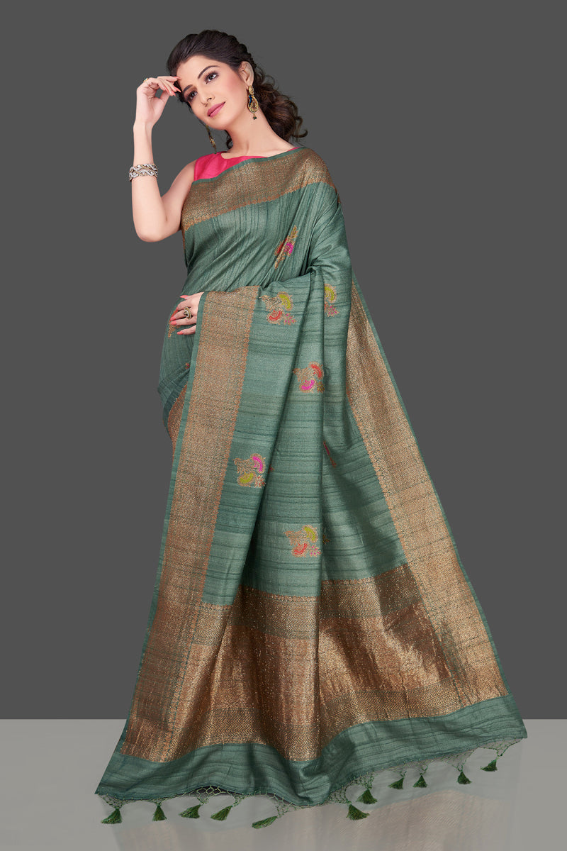 Shop elegant green tussar Banarasi sari online in USA with antique zari minakari buta. Shop beautiful Banarasi sarees, tussar sarees, pure muga silk sarees in USA from Pure Elegance Indian fashion boutique in USA. Get spoiled for choices with a splendid variety of Indian saris to choose from! Shop now.-full view