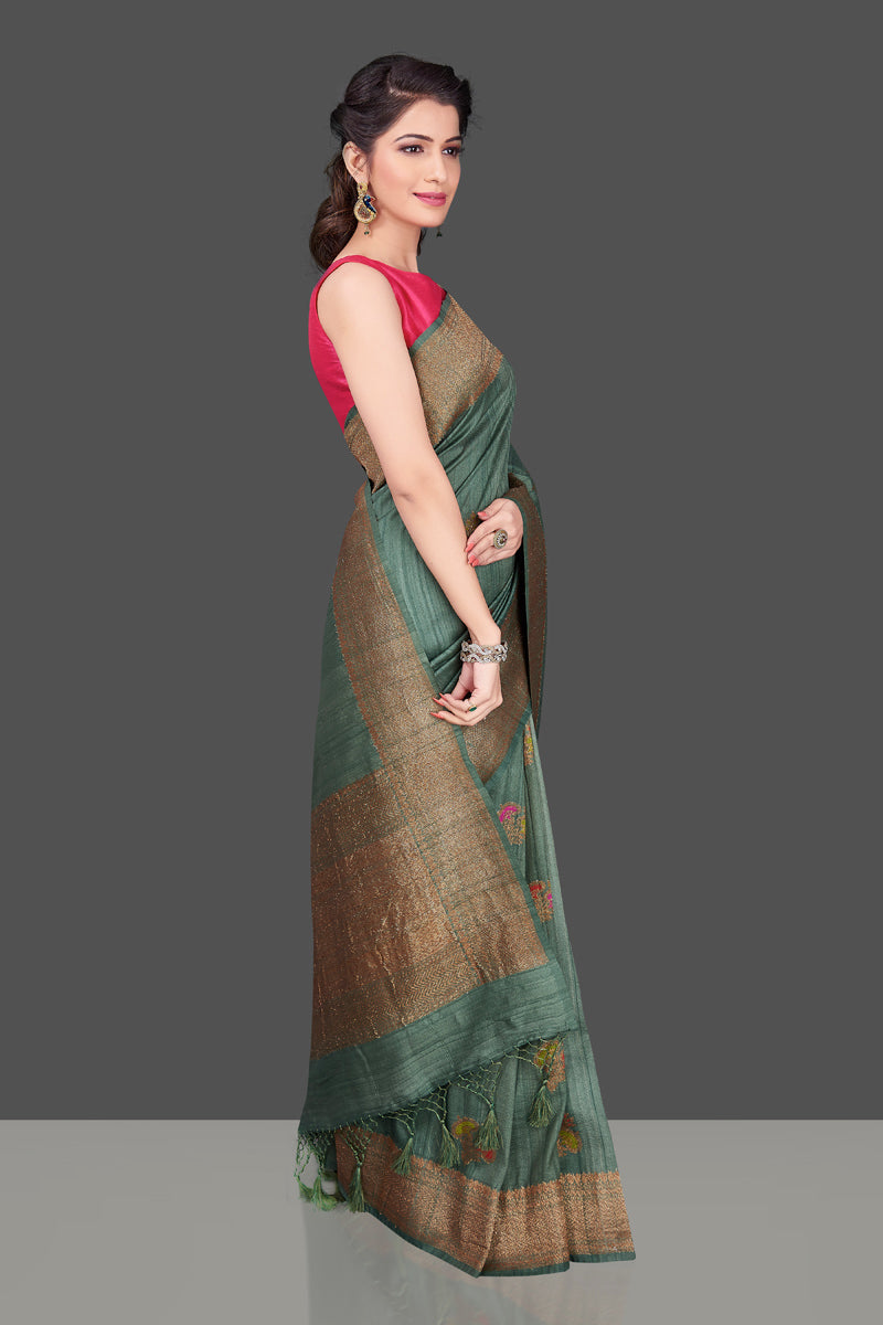 Shop elegant green tussar Banarasi sari online in USA with antique zari minakari buta. Shop beautiful Banarasi sarees, tussar sarees, pure muga silk sarees in USA from Pure Elegance Indian fashion boutique in USA. Get spoiled for choices with a splendid variety of Indian saris to choose from! Shop now.-side