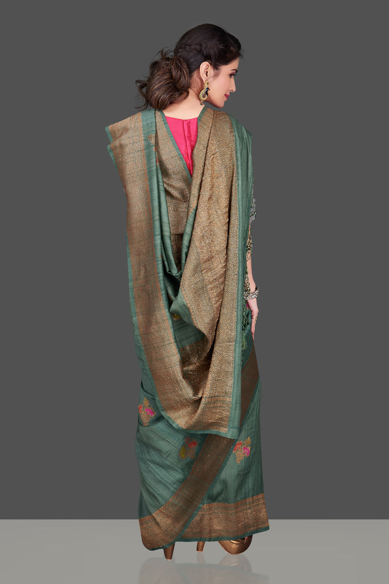 Shop elegant green tussar Banarasi sari online in USA with antique zari minakari buta. Shop beautiful Banarasi sarees, tussar sarees, pure muga silk sarees in USA from Pure Elegance Indian fashion boutique in USA. Get spoiled for choices with a splendid variety of Indian saris to choose from! Shop now.-back