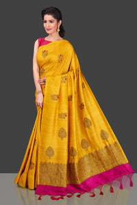 Buy gorgeous yellow borderless muga Banarasi saree online in USA with floral bunch zari buta. Shop beautiful Banarasi sarees, georgette sarees, pure muga silk sarees in USA from Pure Elegance Indian fashion boutique in USA. Get spoiled for choices with a splendid variety of Indian saris to choose from! Shop now.-full view