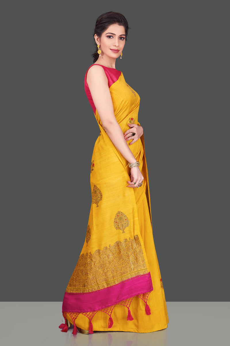 Buy gorgeous yellow borderless muga Banarasi saree online in USA with floral bunch zari buta. Shop beautiful Banarasi sarees, georgette sarees, pure muga silk sarees in USA from Pure Elegance Indian fashion boutique in USA. Get spoiled for choices with a splendid variety of Indian saris to choose from! Shop now.-side