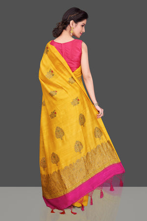 Buy gorgeous yellow borderless muga Banarasi saree online in USA with floral bunch zari buta. Shop beautiful Banarasi sarees, georgette sarees, pure muga silk sarees in USA from Pure Elegance Indian fashion boutique in USA. Get spoiled for choices with a splendid variety of Indian saris to choose from! Shop now.-back