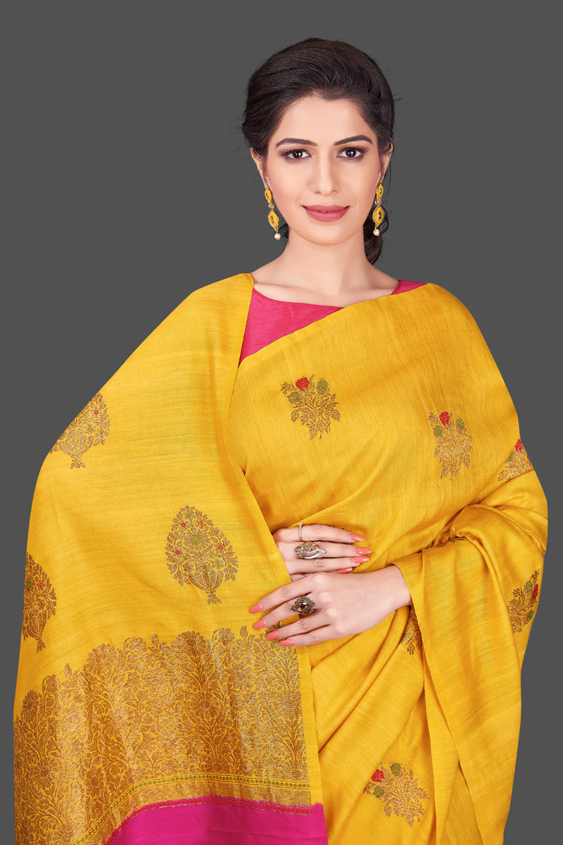 Buy gorgeous yellow borderless muga Banarasi saree online in USA with floral bunch zari buta. Shop beautiful Banarasi sarees, georgette sarees, pure muga silk sarees in USA from Pure Elegance Indian fashion boutique in USA. Get spoiled for choices with a splendid variety of Indian saris to choose from! Shop now.-front