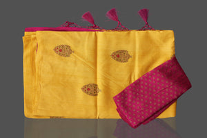 Buy gorgeous yellow borderless muga Banarasi saree online in USA with floral bunch zari buta. Shop beautiful Banarasi sarees, georgette sarees, pure muga silk sarees in USA from Pure Elegance Indian fashion boutique in USA. Get spoiled for choices with a splendid variety of Indian saris to choose from! Shop now.-details