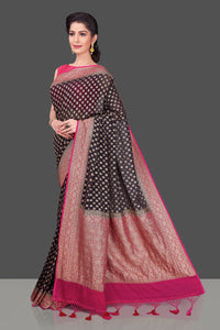 Shop beautiful black georgette Banarasi saree online in USA with pink zari border. Shop beautiful Banarasi sarees, georgette sarees, pure muga silk sarees in USA from Pure Elegance Indian fashion boutique in USA. Get spoiled for choices with a splendid variety of Indian saris to choose from! Shop now.-full view