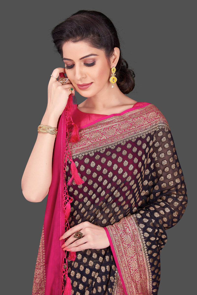 Shop beautiful black georgette Banarasi saree online in USA with pink zari border. Shop beautiful Banarasi sarees, georgette sarees, pure muga silk sarees in USA from Pure Elegance Indian fashion boutique in USA. Get spoiled for choices with a splendid variety of Indian saris to choose from! Shop now.-closeup