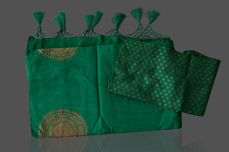 Buy bottle green borderless muga Banarasi sari online in USA with big antique zari buta. Shop beautiful Banarasi sarees, georgette sarees, pure muga silk sarees in USA from Pure Elegance Indian fashion boutique in USA. Get spoiled for choices with a splendid variety of Indian saris to choose from! Shop now.-details