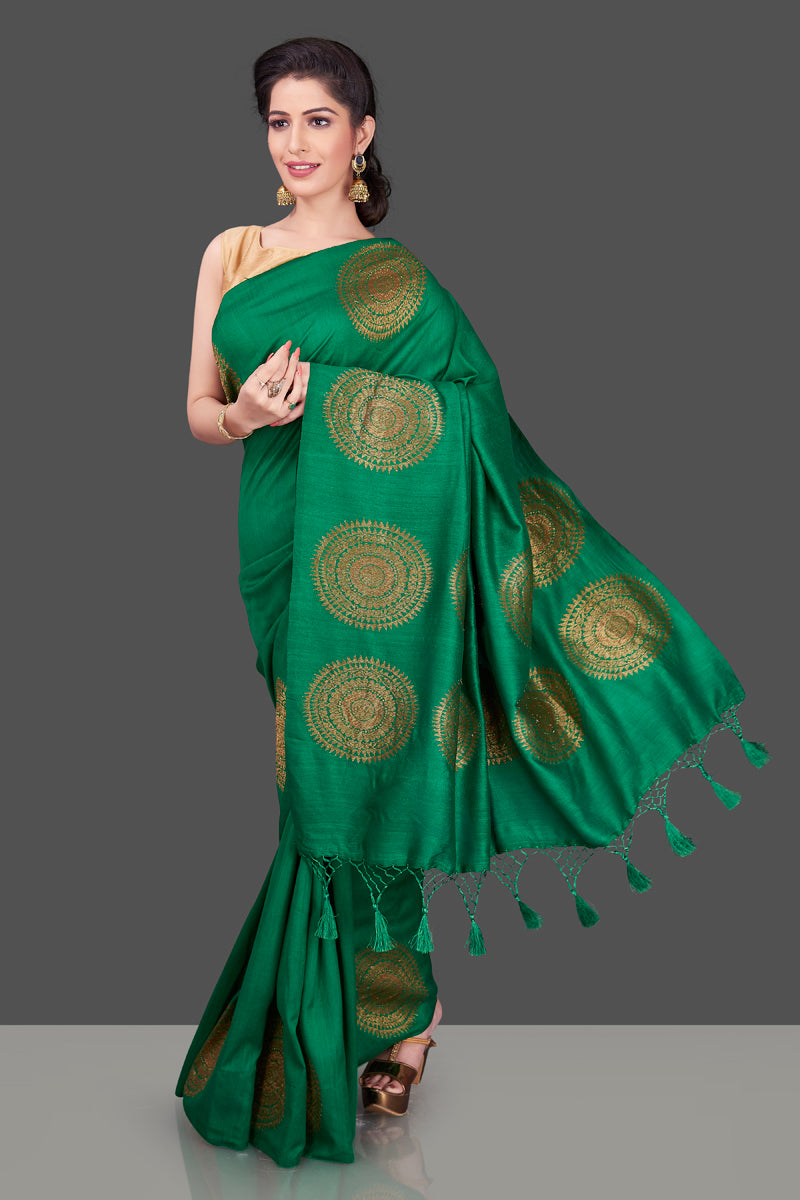 Buy bottle green borderless muga Banarasi sari online in USA with big antique zari buta. Shop beautiful Banarasi sarees, georgette sarees, pure muga silk sarees in USA from Pure Elegance Indian fashion boutique in USA. Get spoiled for choices with a splendid variety of Indian saris to choose from! Shop now.-front