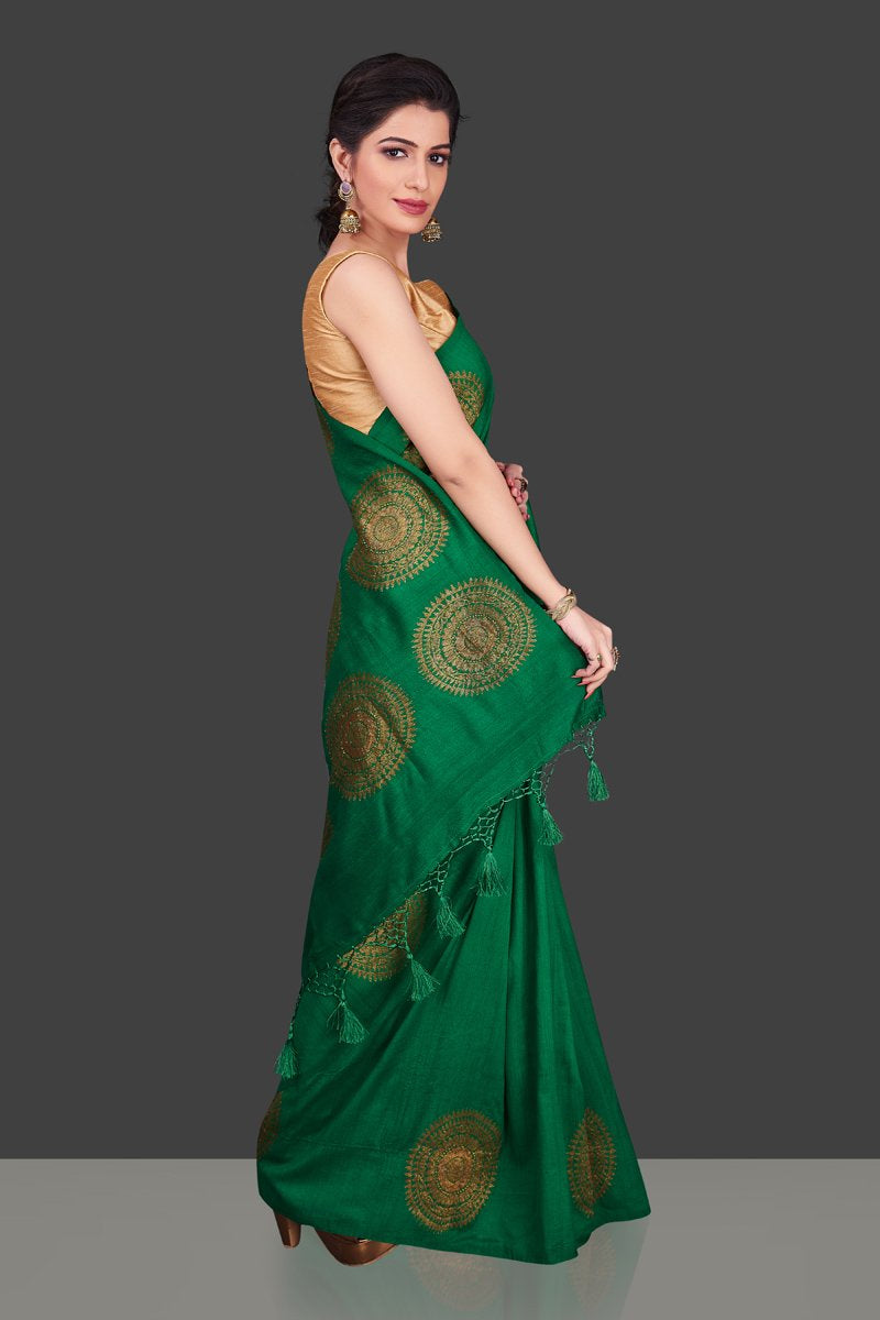 Buy bottle green borderless muga Banarasi sari online in USA with big antique zari buta. Shop beautiful Banarasi sarees, georgette sarees, pure muga silk sarees in USA from Pure Elegance Indian fashion boutique in USA. Get spoiled for choices with a splendid variety of Indian saris to choose from! Shop now.-side